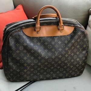 Louis Vuitton Alize 2 way travel bag carry on